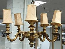 A gilt wood five-light electrolier with carved surmount