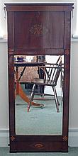 An early 19th Century mahogany pier glass with chequer inlaid cornice above a deep panel frieze inset a marquetry oval decorated with vase of flowers above a rectangular plate, the frame with flowerhead corners and shell inlaid base, 130cm x 57cm