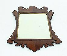 A George II mahogany fret carved mirror with rectangular bevelled plate, 84cm x 55cm
