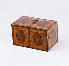 A George III satinwood and inlaid tea caddy, the hinged cover centred by a brass handle and enclosin