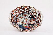 A Worcester two-handled oval basket, circa 1765, the interior with a pavilion in the Imari palette,