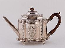 A George III silver teapot and stand, Robert Hennell, London 1788, of serpentine outline, fitted a f