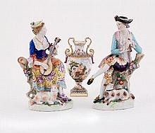 A pair of Continental porcelain figures of shepherd and shepherdess musicians, late 19th Century, bl