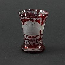 A Bohemian glass goblet etched named buildings with scrolling borders and trailing vines to the base