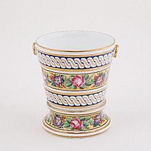 A French porcelain cache-pot, circa 1810, painted with a band of flowers on a yellow ground between