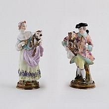 A pair of German porcelain figural scent bottles, late 19th Century, modelled as a maiden and gallan