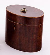 A George III mahogany oval tea caddy, with boxwood strung borders and having brass ring handles to t