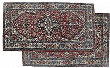 A pair of Isfahan rugs, each with central indigo