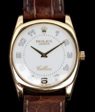 A Gentleman's Rolex Cellini 'Danaos' wristwatch, model 4233, the 18ct gold case with Arabic numerals, stamped 18K, the buckle stamped 750, on a brown crocodile strap, serial number K658413, boxed with original guarantee