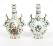 A pair of faience two-handled vases and covers, painted flowers, 25cm high