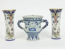 A late Delft loving cup, 22cm high and two faience vases