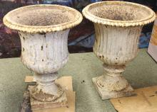 A pair of Coalbrookdale urns, with fluted sides on square bases, 47cm diameter