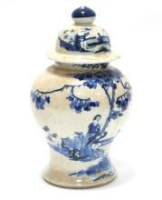 A 19th Century blue and white vase and cover, of baluster form, decorated with figures in a landscape, 42cm high