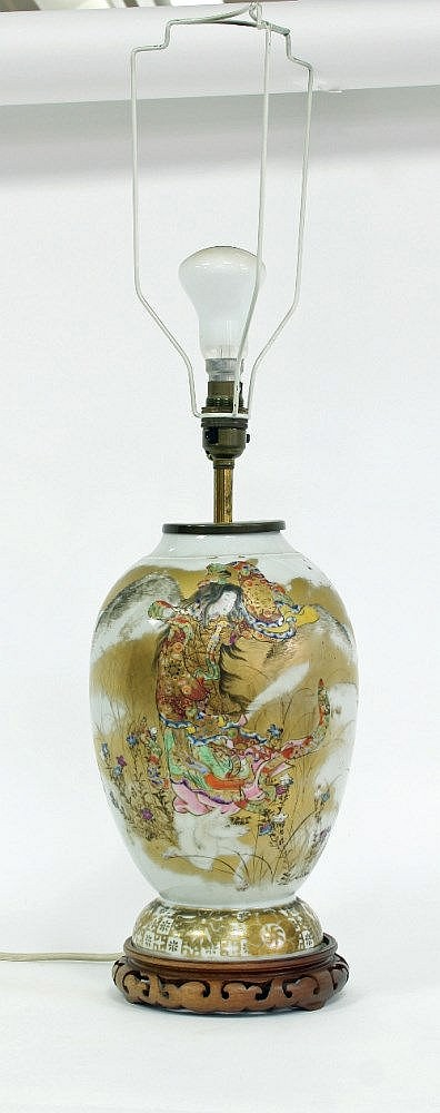A Japanese porcelain lamp, decorated figures in