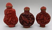 A Grouping of Chinese Cinnabar Snuff Bottles