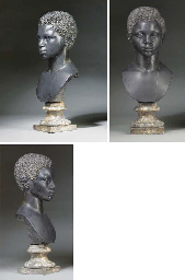 A CARVED BLACK MARBLE BUST OF A YOUNG MOOR