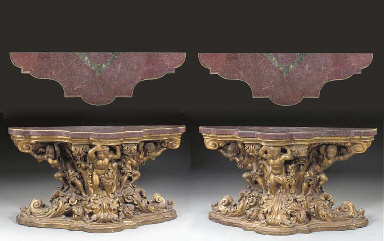 A PAIR OF NORTH ITALIAN BAROQUE GILTWOOD AND ORMOLU-MOUNTED EGYPTIAN PORPHYRY SIDE TABLES