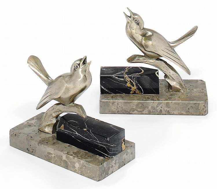 A PAIR OF LOUIS-ALBERT CARVIN SILVERED BRONZE 'BIRD' BOOKENDS