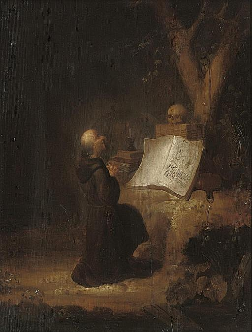 A hermit monk at prayer in a landscape