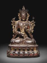 A GILT-BRONZE FIGURE OF AVALOKITESHVARA