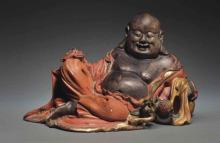 AN UNUSUAL LACQURED AND GILDED  ZITAN  FIGURE OF BUDAI