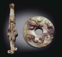 TWO PALE BEIGISH-GREY AND RUSSET JADE ARCHAISTIC CARVINGS