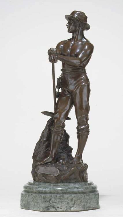 A FRENCH BRONZE FIGURE OF A MINOR
