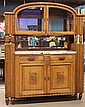 French Art Deco buffet, executed in oak circa 1920, the mirrored superstructure with bevelled glass doors above an open gallery term...