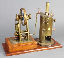 A frame vertical  brass steam plant model, 19th century, having a vertical boiler, with a vertical A frame centering the 5