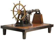 An exhibition standard model of a marine ship's wheel with double cylinder steam powered turning mechanism, worm gear operated to ro..