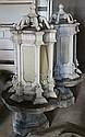 Pair of Victorian metal lanterns on stone base