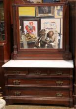Victorian Eastlake walnut carved dresser, having a marble top, above a five drawer case,  68