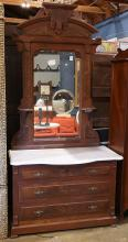 American late Victorian dresser, with a marble top, having a three drawer case,  83