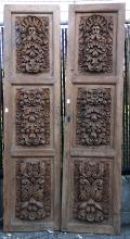 Pair of heavily carved Spanish Colonial style wooden doors