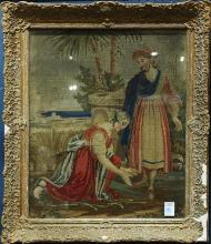 Framed needlepoint depicting a woman washing Jesus' feet