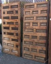 Pair of Spanish carved walnut paneled doors, 74