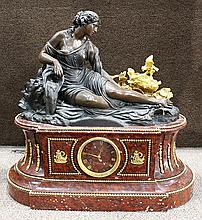 Louis XVI style Deniere patinated bronze and marble figural clock