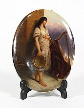 KPM porcelain plaque, depicting a gypsy with tambourine, 19th century, the barefoot girl holding a tambourine with a harp in the lan...