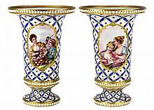 Pair of French porcelain beaker vases, each accented with polychrome painted halcyon figures, the reverse with a watery landscape wi...
