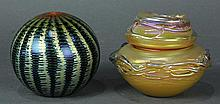 (Lot of 2) Lundberg Studios art glass group, consisting of a lidded vessel in gold and green, together with a gold spherical paperwe...