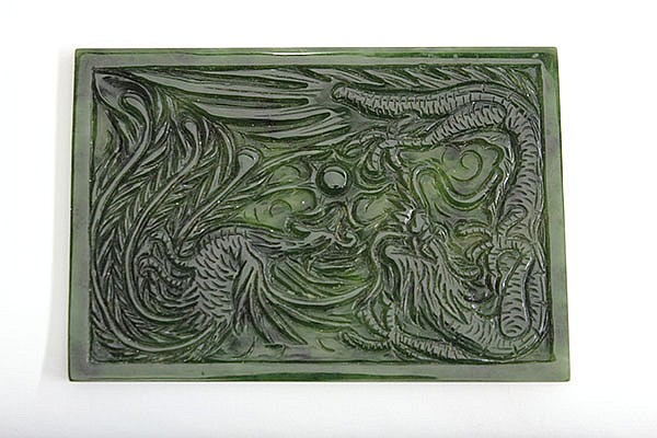Chinese spinach jade plaque, carved with a stylized phoenix and a dragon pursuing a jewel, 3.75