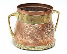 Copper and brass chestnut roaster in the style of Carl Deffner, having pierced brass band at the neck above a vessel with reserves, ...