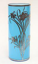 Art Nouveau silver overlaid vase, the cylindrical blue glass body accented with silver floral sprays continuing on the circular base...