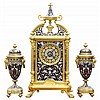 French ormolu mounted and champleve decorated clock with garniture
