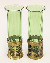 Pair of French gilt bronze mounted vases, each having a columnar blue green liner in  a fitted gilt bronze cuff, accented with rams ...