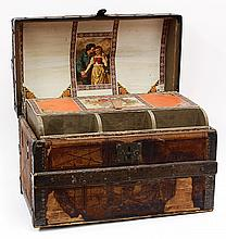 (lot of 2) Victorian leather, oak, and wrought iron trunk, having a tiered interior, the top case accented with period paper, liftin...