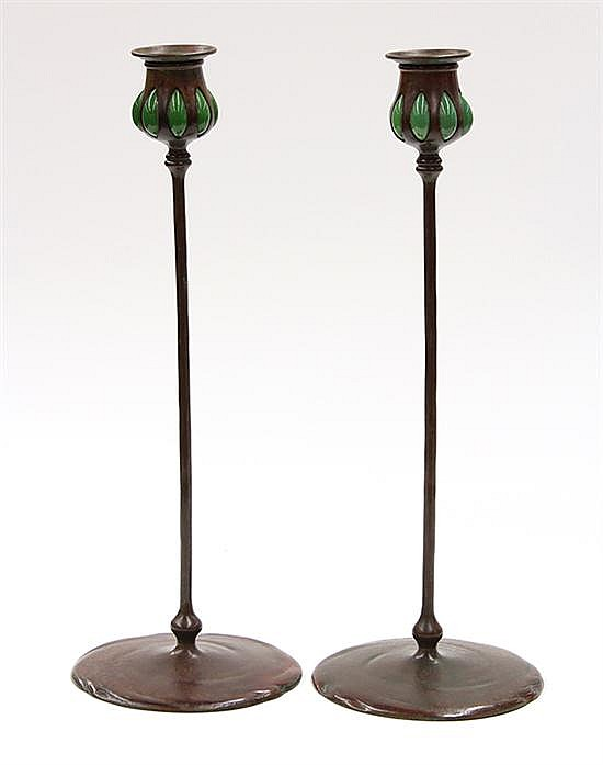 Arts and Crafts patinated bronze candlesticks