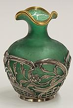 Daum, France art glass vase, the bulbous form having a shaped gilt rim surmounting the mottled emerald body fronted with the reticul...