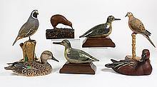 (lot of 7) Figural groups depicting birds, each in polychrome painted wood, including a quail; a hen green wing teal; and a bird per...