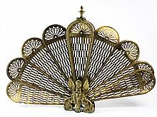 Victorian pierced brass figural fireplace fan screen centered with a griffin and resting on scroll supports, 25
